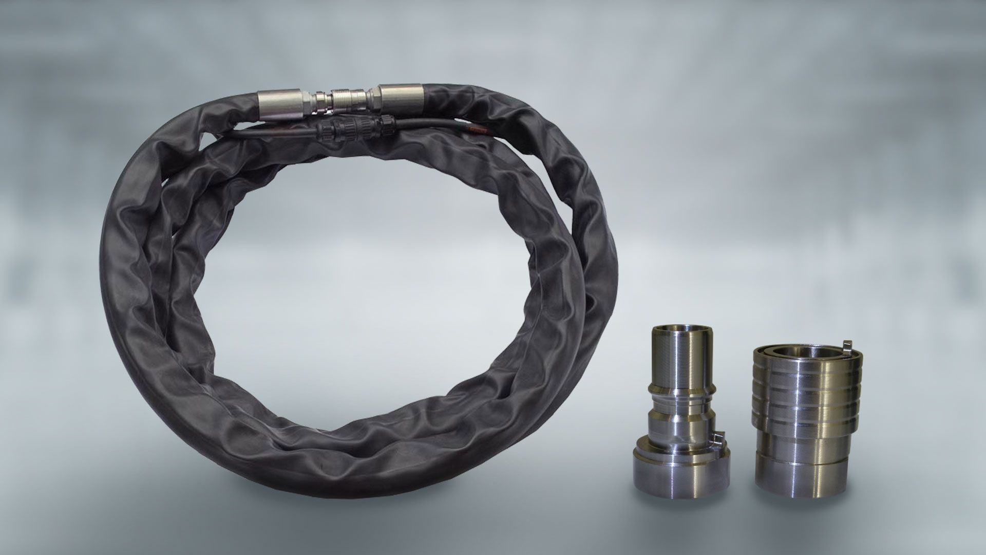 The hose bundle of White Lion (left), the male part (middle) and the female part of the coupling (right)